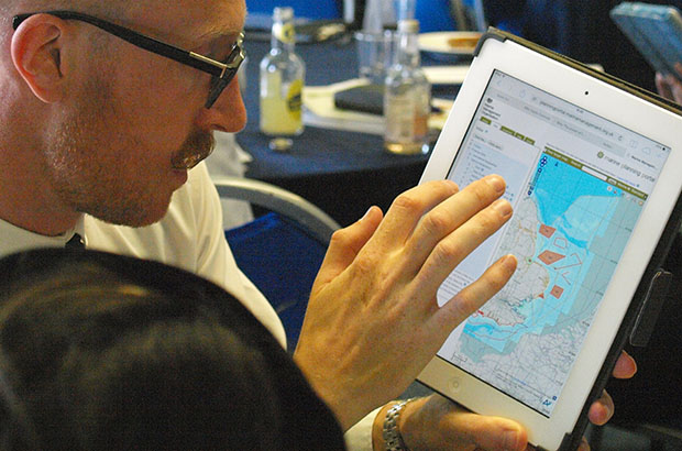 Marine planner shows stakeholder an online planning tool