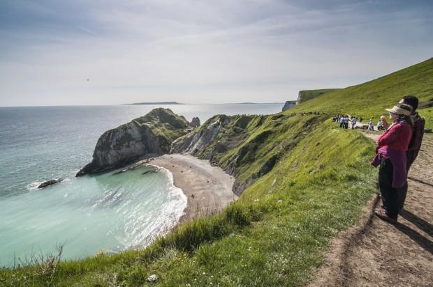 Tourist enjoying beautiful scenery at the Jurassic Coast, Dorset,