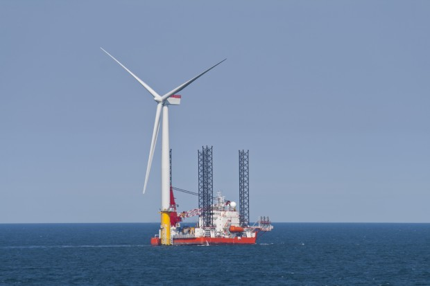 Wind turbine off the Norfolk Coast being constructed by a jack-up vessel