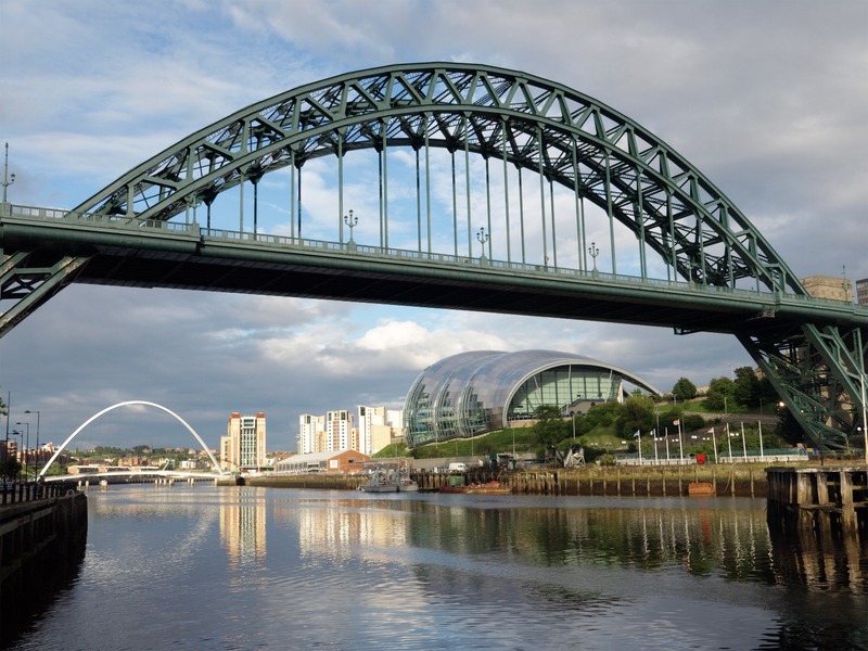 A view of the Tyne Bridge in Newcastle, with the Gateshead Millennium bridge and the Sage Centre in the background.