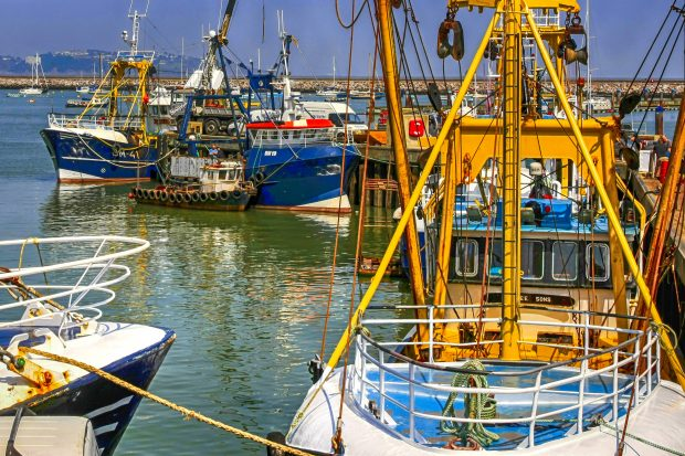 Brixham, United Kingdom - May 2, 2012: Fishing boats in the commercial harbor at Brixham UK