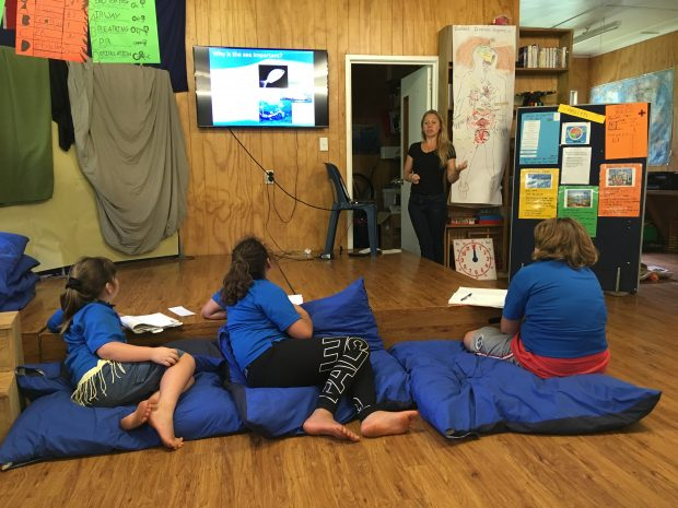 Children on Pitcairn Island learning about the Blue Belt Programme