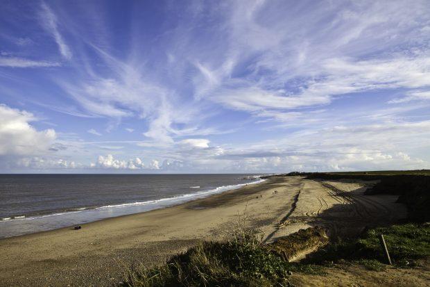 Stretch of coastline and blue sky.
