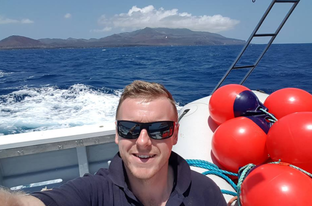 Dan on board a boat in the sea around St Helena.