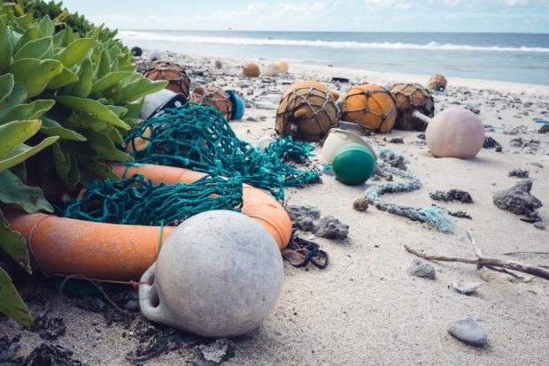 Washed up nets and letter on beach